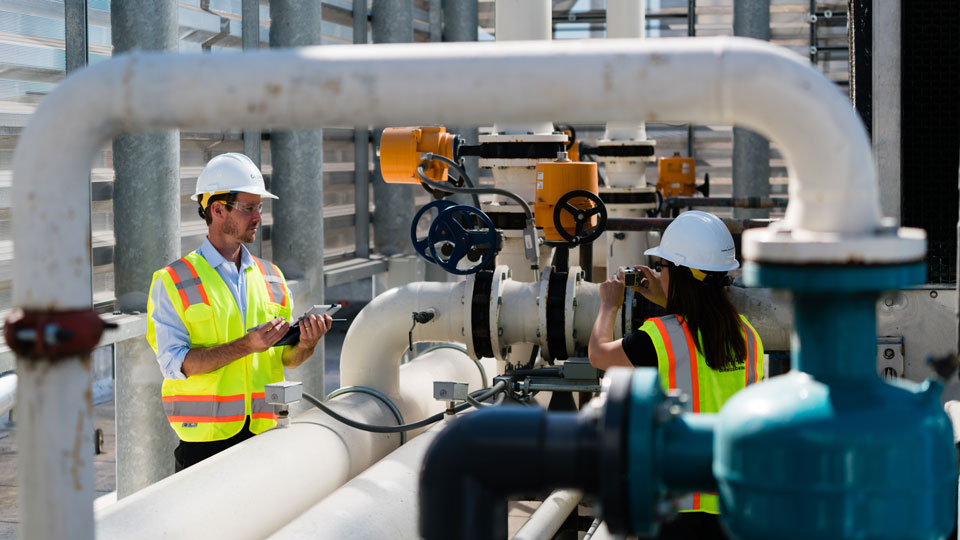 Tetra Tech Commissioning Agents examine rooftop mechanical systems