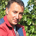 Macedonian farmer shows off grapes grown on his farm to meet market demand.