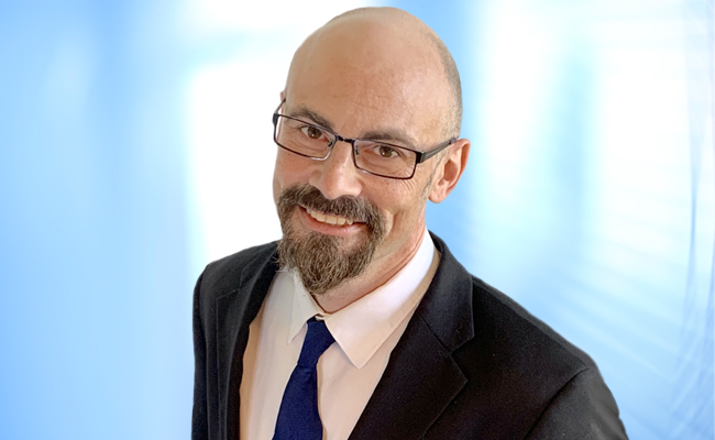 Headshot of AJ Guikema.