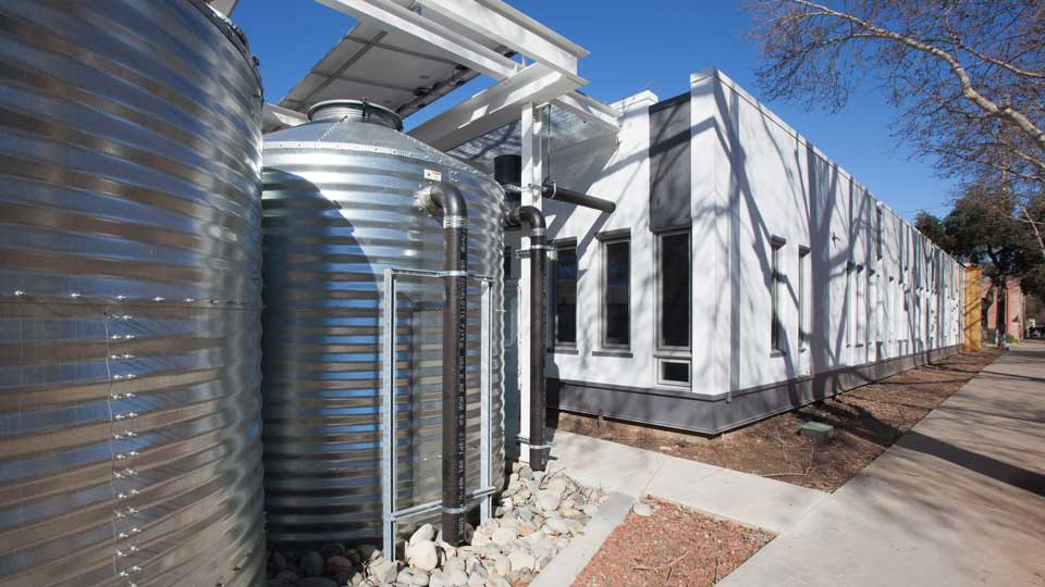 Rainwater harvesting cisterns at Arch|Nexus SAC help the building achieve Net-Positive Water