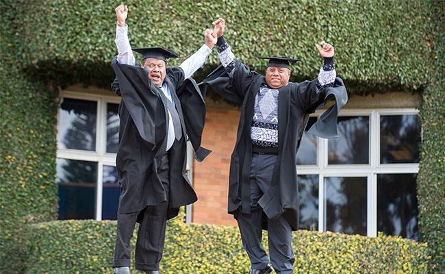 Australia Awards scholars celebrating their graduation.