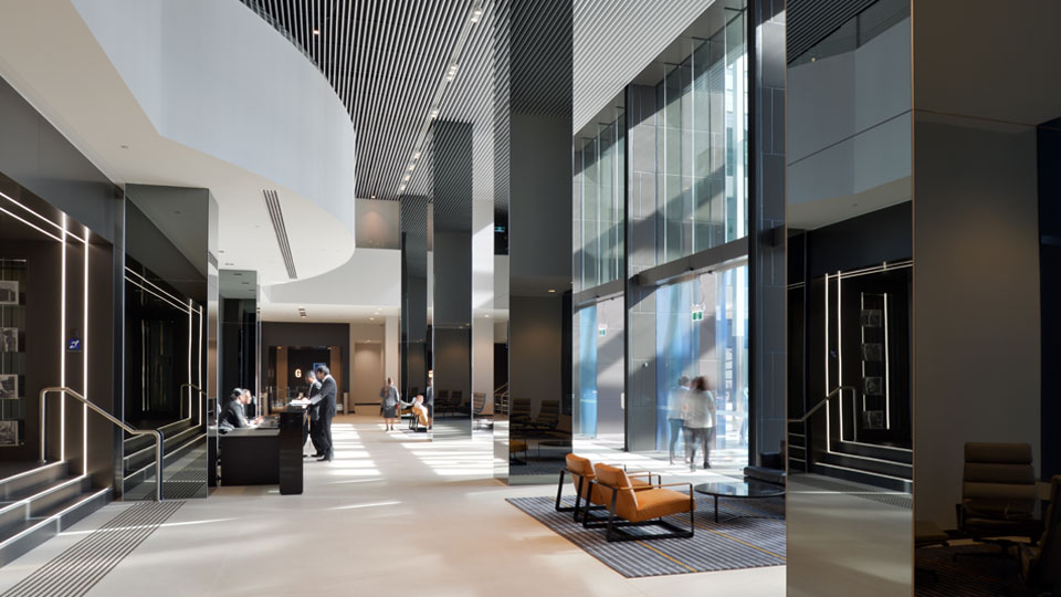 The new building is a thriving hub of communication and collaboration with open and connected workspaces.