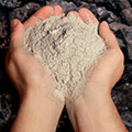 Fly ash reacts with calcium hydroxide in the presence of water to form cementitious compounds