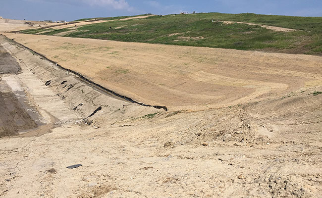 Erosion control measures applied on a landfill side slope
