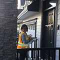 An outreach team member is ready to engage residents about food scraps diversion and their new trash collection schedule