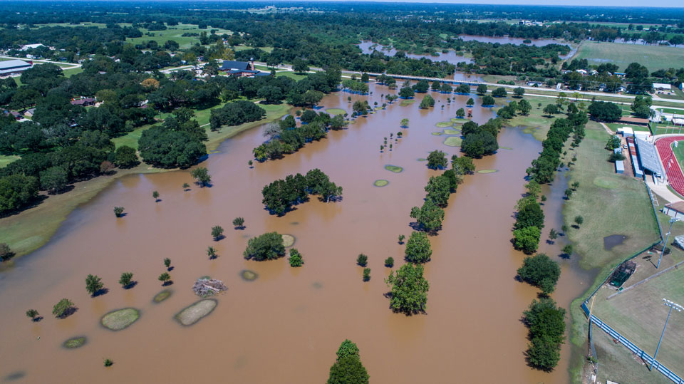 Large-scale flooding in an urban area of the United States submerges streets and impacts infrastructure
