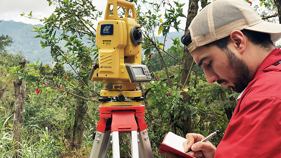 Engineer uses equipment to plan and design the implementation of a clean water source for the community of La Reforma.