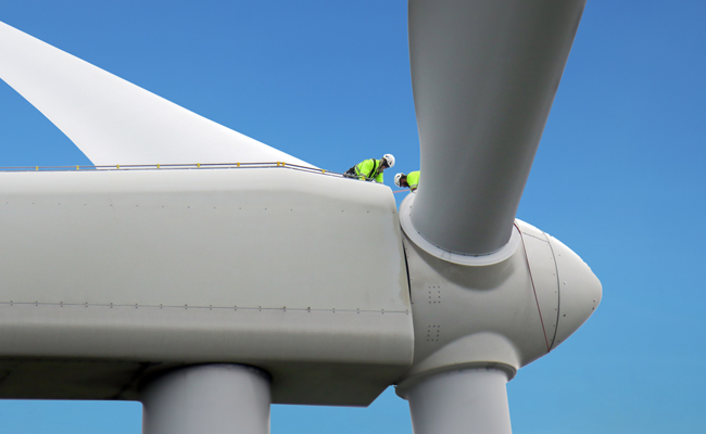 Works in PPE work on the nacel of a wind turbine