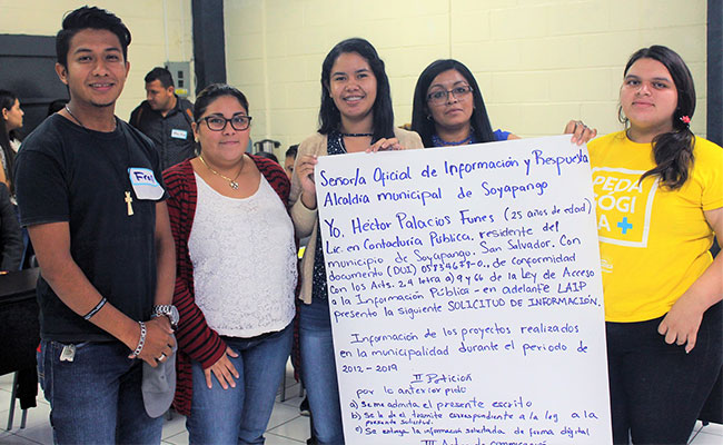 A group of university students show the public information request they wrote as part of a citizen oversight training.