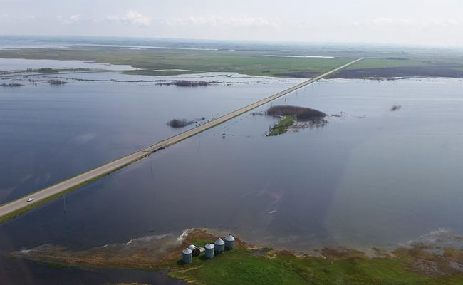 Rising water of the Quill Lakes threatening Highways 6 and 16.