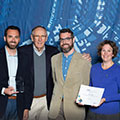 Tetra Tech employees pose with founder of Esri, Jack Dangermond, after receiving an Esri SAG Award