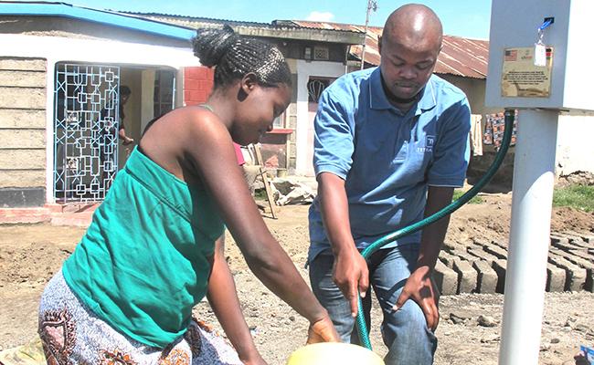 SUWASA Staff assisting Nakuru resident