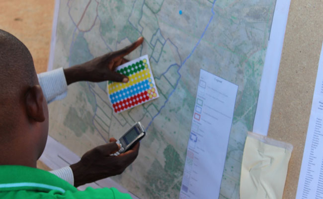 Local community members are trained on the new mobile database tool and how it relates to land parcel administration