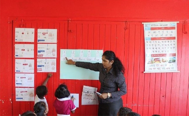 Students learning basic numeracy skills  as part of the Tetra Tech-supported Australia Awards program