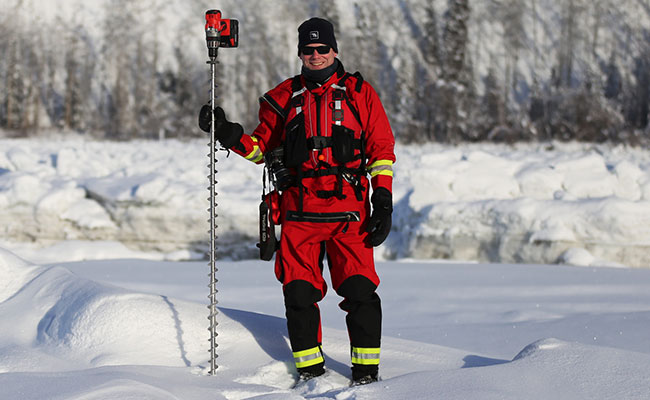 Tetra Tech staff conduct first-on-ice testing on a river.
