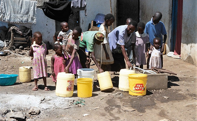 In Hawassa, Ethiopia, children wait in line to fill up jerry cans with water.