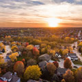 Aerial view of a homes, streets, and green open space in a resilient community