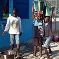 Children use the mini-system designed by Tetra Tech in Voinjama