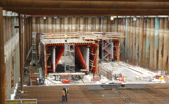 Construction of the tunnel sections inside the piled and propped casting bay.