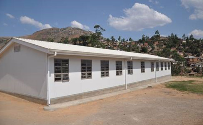 The SEED Project expands existing urban schools with prefabricated classroom blocks.