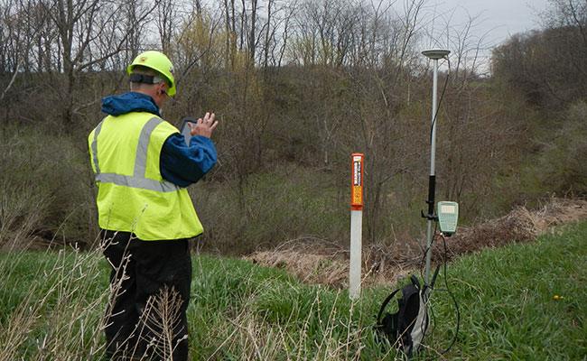 Tetra Tech employee conducts a field data collection for an environmental compliance project for an industrial client.