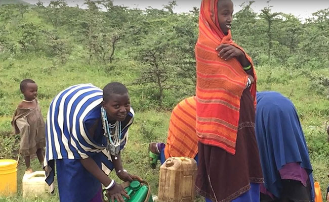 Working with a Maasai community to design and construct a gravity pipeline, related storage, and public tapstands