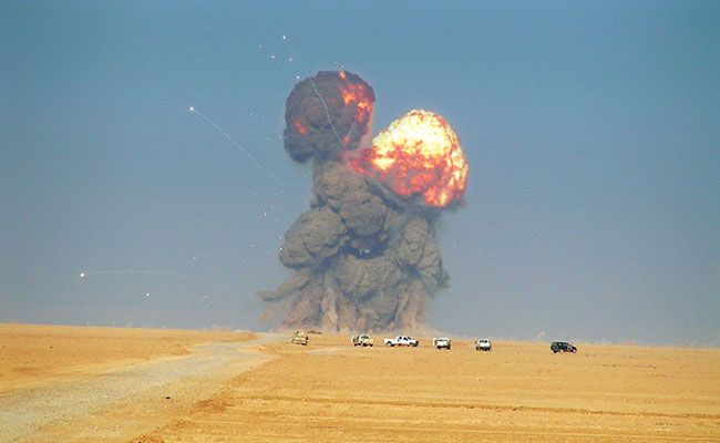 Demolition shot to destroy excess stockpiled munitions and unexploded ordnance in Iraq