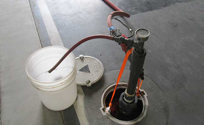 Emulsified vegetable oil and commercially available microbial cultures were injected into groundwater injection wells to