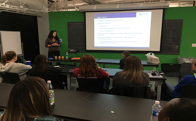 A Tetra Tech employee addresses a group of female engineering students to discuss  innovations in wind technology