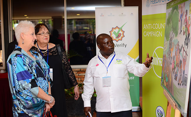 Beneficiary from the Anti-Counterfeit Campaign highlighting their impact in Uganda over the past 5 years to U.S. Ambassa