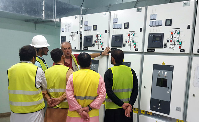 Workers attending demonstration of technology in Afghanistan