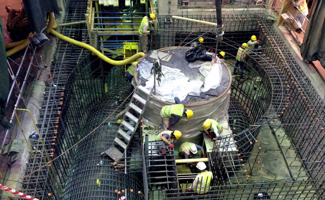 Engineers working on the repair of the new turbine generator in Kajaki Plant