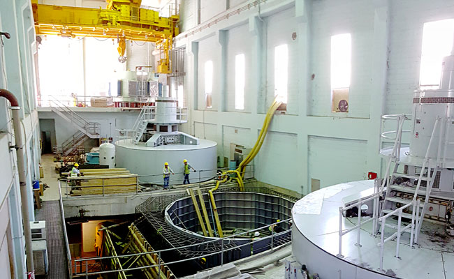 Inside Kajaki Plant, engineers working on turbine generators