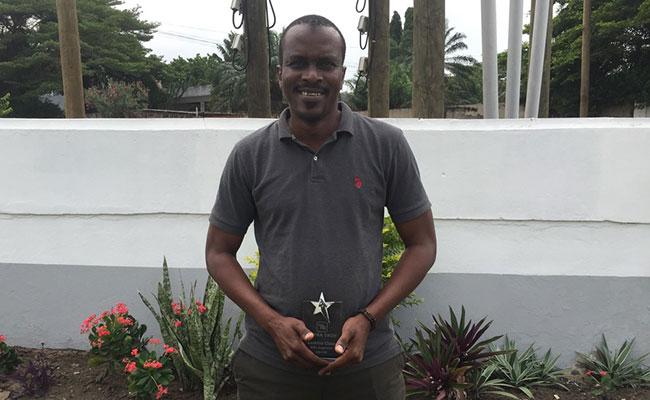 Lamine receives the MEL Superstar award plaque in Ghana