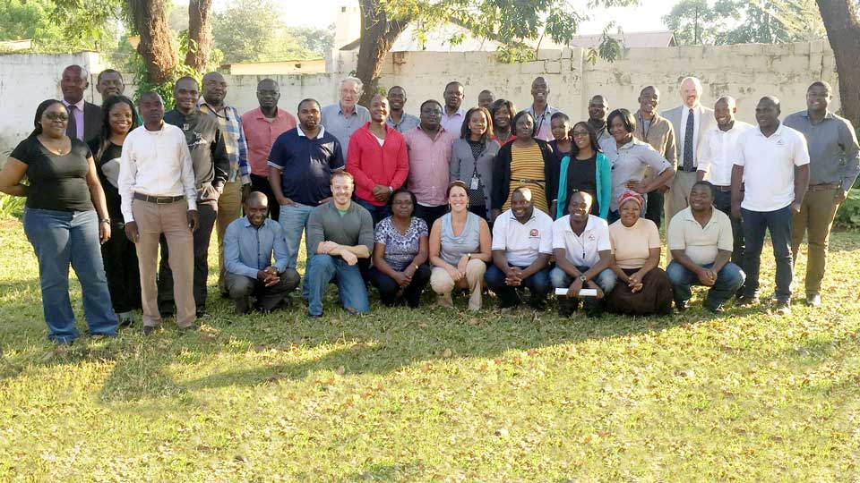 The award-winning Lusaka Supply, Sanitation, and Drainage Project team poses for a picture in Zambia.