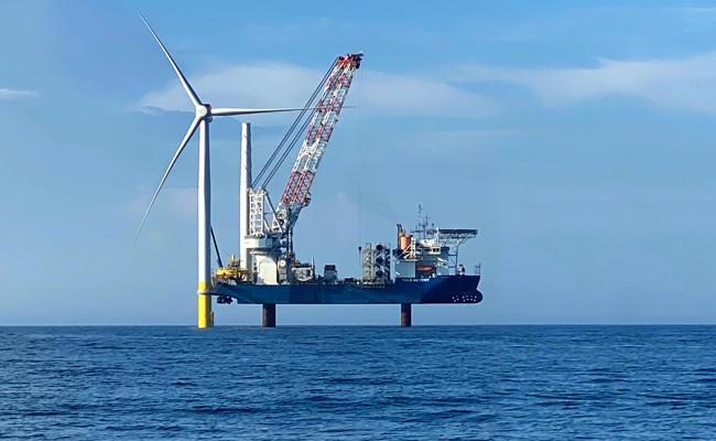 Offshore wind turbine pictured in the ocean
