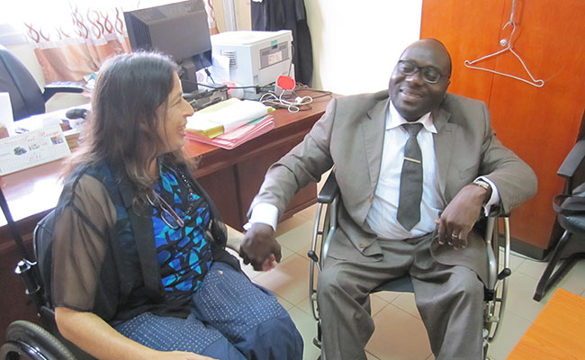 International disability rights expert, Susan Scheer, sharing her expertise with Judge Jean-Baptiste Angaman at Yopougon