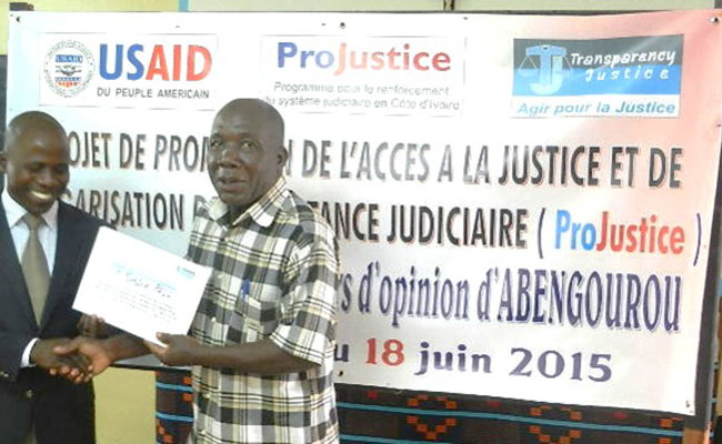 A village chief in Abengourou receiving his diploma for completing a course on access to justice and judicial assistance