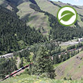 Train running down Meacham Creek valley in Eastern Oregon where Tetra Tech removed levees and spur dikes.