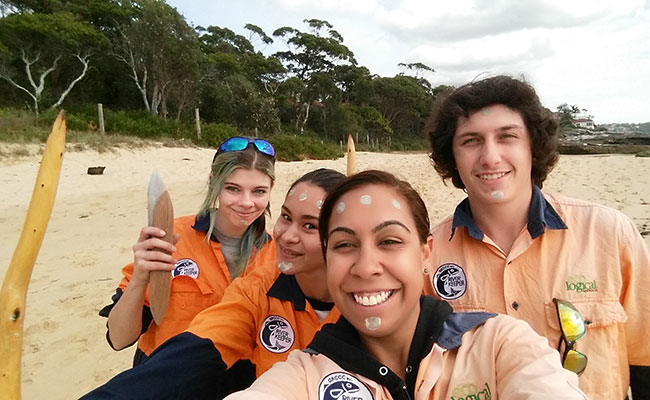 Aboriginal Riverkeeper trainees during an Aboriginal cultural day at Jibbon Beach Sydney, NSW, Australia.