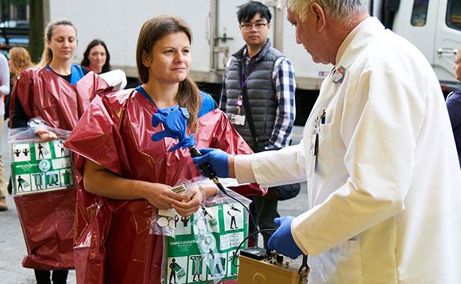 NYU Langone Health's Radiation Safety staff conducting readings for radiation contamination.