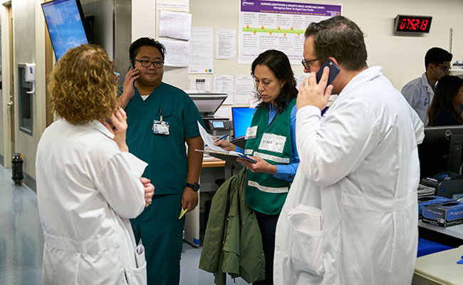 NYU Langone Health's Emergency Department Staff at Tisch Hospital having a coordination conversation.