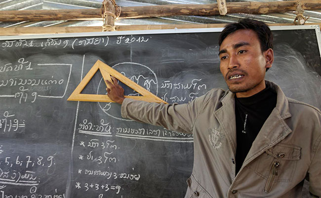 A Laos teacher instructs children in a refurbished classroom