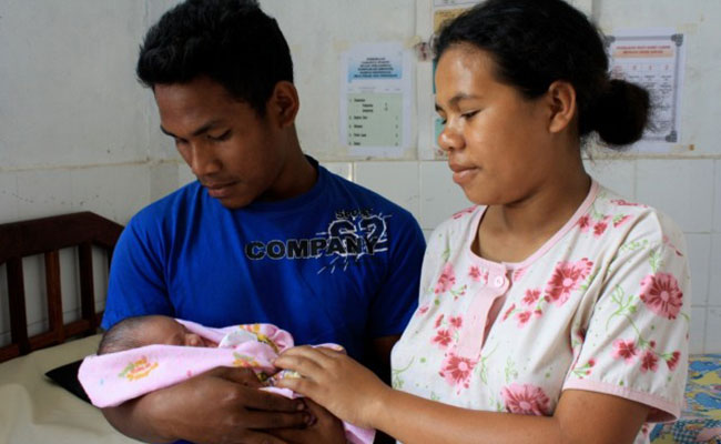 New parents visit the local community maternal and child health service as part of the Australia Indonesia Partnership f