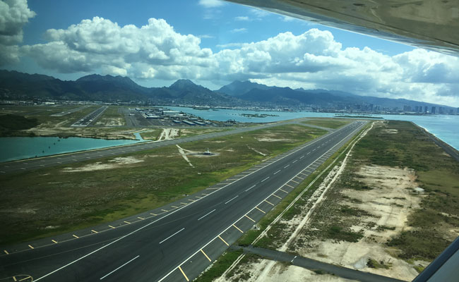 Low lying areas such as Honolulu's Daniel K. Inouye International Airport would be increasingly exposed to chronic coast