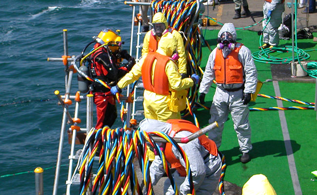 Deck operations to assist UXO divers returning to the surface during chemical weapons recovery in Japan