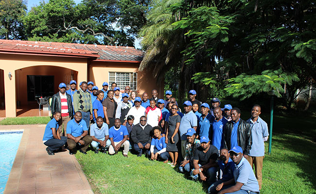 The project team poses for a group photo in Zambia
