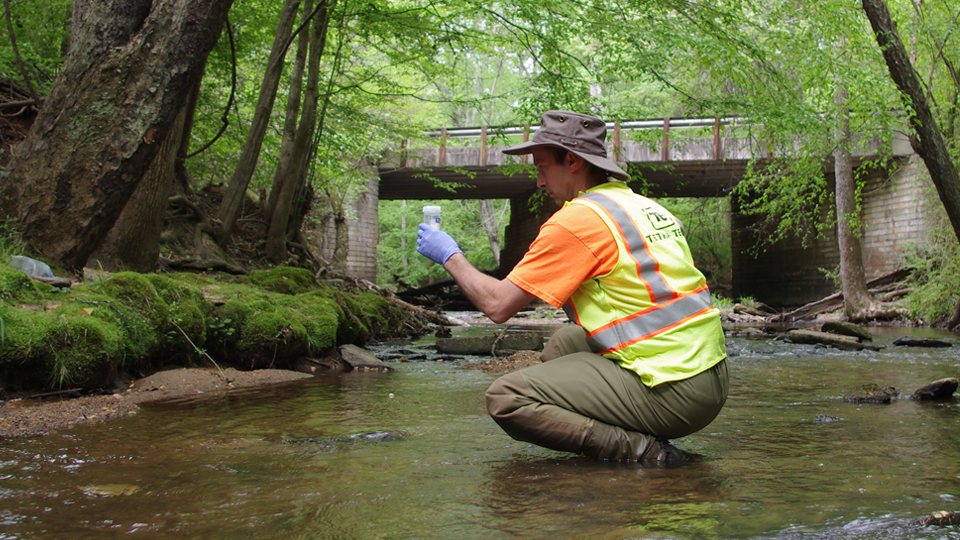 Tetra Tech collects water quality sample in an urban stream outside of Atlanta, Georgia.