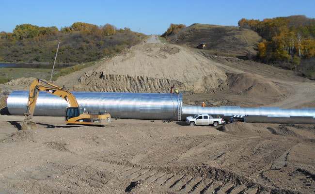 Installing 4.9-meter (16 foot) -diameter multiplate structure through Highway 22