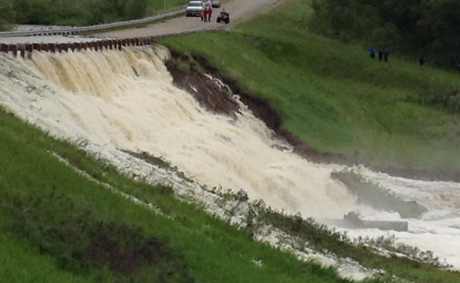 Pearl Creek flooding Highway 22 during embankment failure